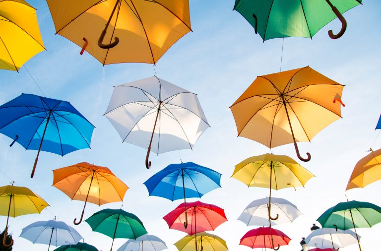 Colourful umbrellas suspended in air