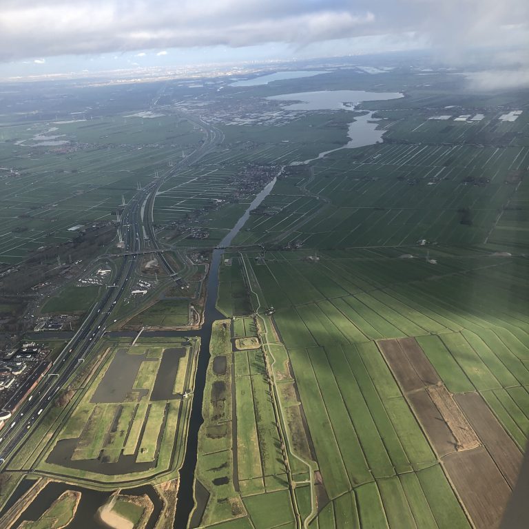 Fields and water seen from sky